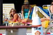 Ashley Greene Sunbathing in a Bikini on the set of 'Staten Island Summer' in New York 09/09/13